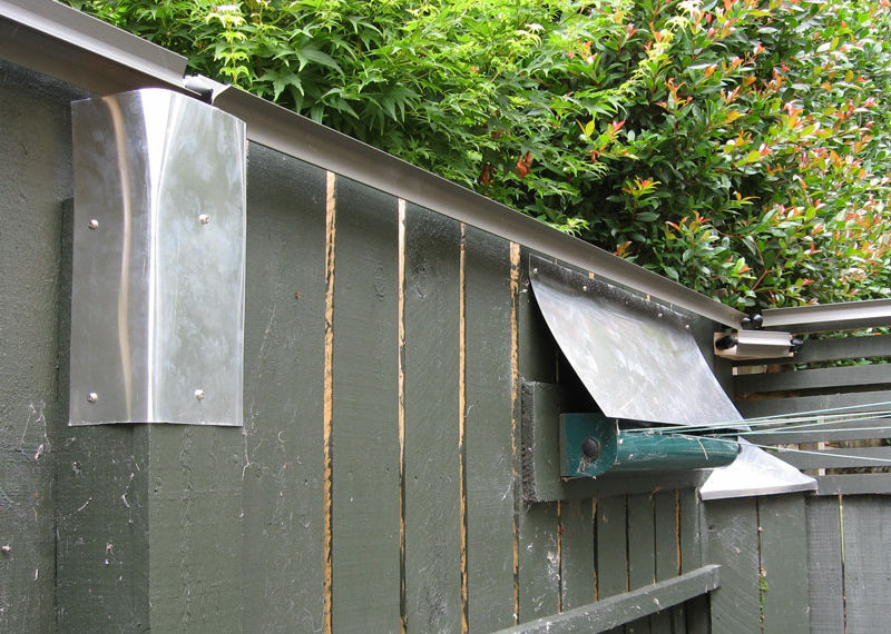 Aluminium shields on fence posts and clothesline in Auckland