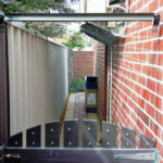 Acrylic used to increase the height of a gate while leaving an obstructed view