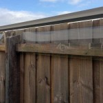 Oscillot on timber fence plus polycarbonate shield to onclose the exposed rail near top of fence which could be a jumping platform for cat
