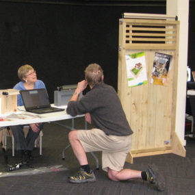 Judee discusses the Oscillot cat fence system with a visitor to the All Breeds Cat Show in Hamilton, New Zealand, 3 July 2016