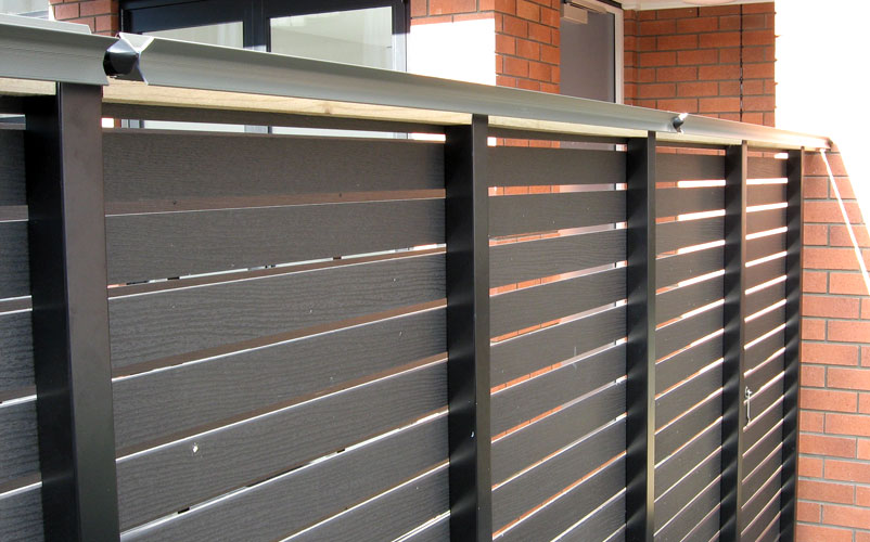 Oscillot paddles attached to aluminium fence posts, with timber behind to close the cap.