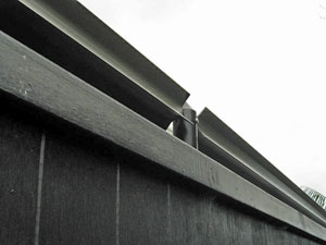 Oscillot on top of timber fence