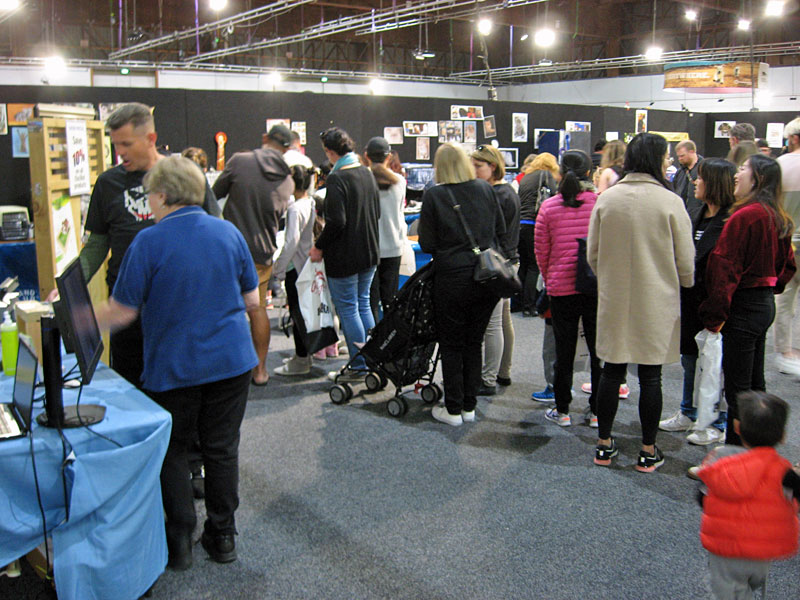 """At times, there were long queues to see the cats on display at the Auckland Cat Club stand. While waiting, people could enjoy our famous """"cat escape attempts"""" video (6.8 million views on Facebook!) and talk with us about cat safety."""