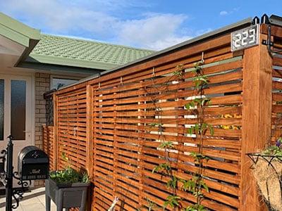 Oscillot system on timber lattice fence